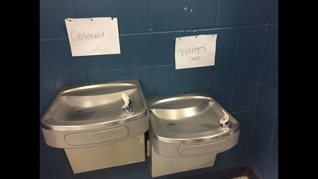 Photo from http://www.wftv.com/news/local/investigation-underway-after-2-racist-signs-posted-above-water-fountains-at-first-coast-high-school/466146633